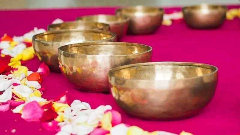 Write Your Journey - Singing Bowl Meditation: Closeup of singing bowls on pink meditation blanket